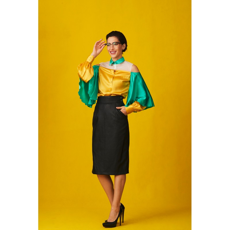 Set of colorful silk shirt and faux leather skirt with a slit on the side