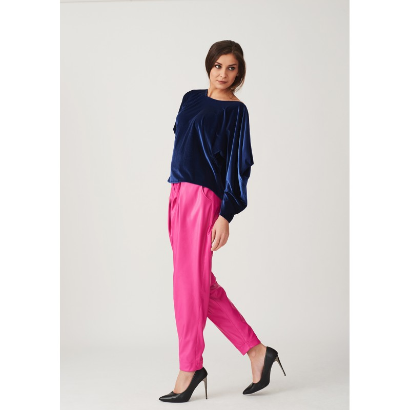 A velvet blouse with draped sleeves