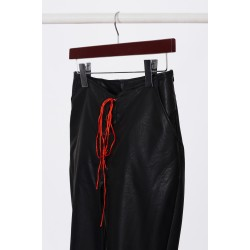 Leather trousers with red accent
